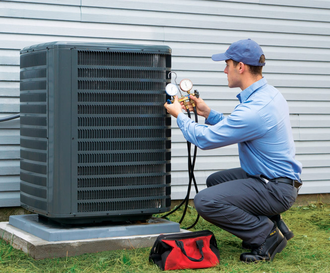 Sila technician performing AC tune-up